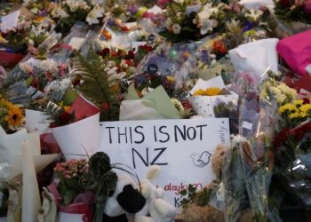 A poster at the makeshift memorial for victims condemning the attack on the mosques in Christchurch