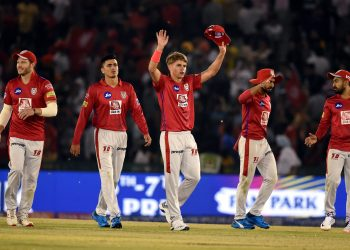 Sam Curran along with team members celebrates after their victory against Delhi Capitals at Mohali, Monday