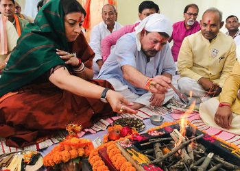 Amethi: Union minister and BJP candidate Smriti Irani along with her husband Zubin Irani performs 'puja' before filing her nomination papers for Amethi Lok Sabha seat, in Amethi, Thursday, April 11, 2019. (PTI Photo)