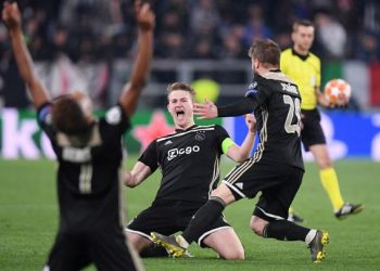 Ajax Amsterdam players celebrate their victory over Juventus in the Champions League quarterfinals, Saturday