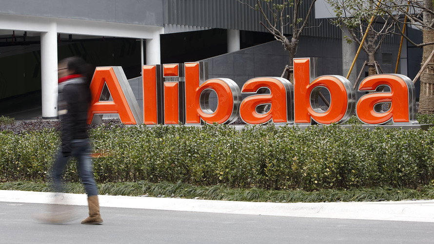 An employee walks past a sign at an Alibaba operations center in Hangzhou, China (REUTERS)