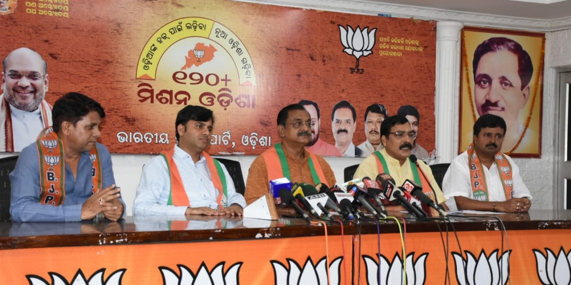 Vice-president of BJP's Odisha unit Samir Mohanty addresses the press conference Wednesday as other leaders look on