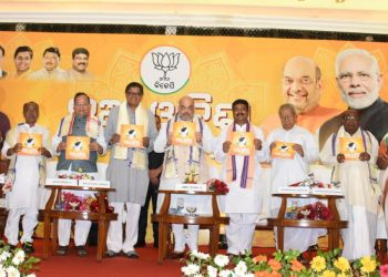 BJP president Amit Shah (C) and other party leaders from Odisha during the launch of the party manifesto in Bhubaneswar, Sunday