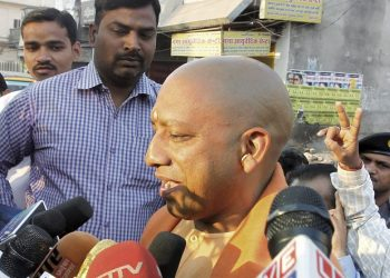 Gorakhpur: BJP MP Yogi Adityanath interacts with media after casting his vote during the sixth phase of the state assembly election in Gorakhpur. (PTI Photo)