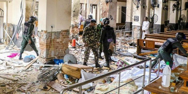 A total of 310 people were killed and over 500 injured in suicide bombings in three Sri Lankan cities Sunday.