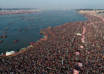 An aerial shot shows a sea of devotees gathered at Sangam to take a holy dip on the occasion of Basant Panchami festival during the Kumbh Mela 2019, in Prayagraj. (PTI Photo)