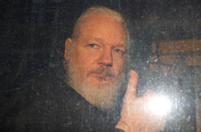 WikiLeaks founder Julian Assange is seen as he leaves a police station in London, Britain April 11, 2019. REUTERS/Peter Nicholls
