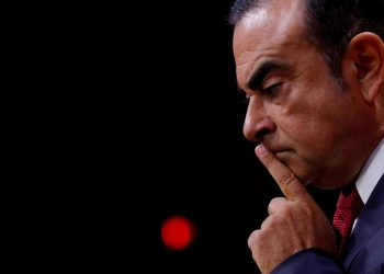 FILE PHOTO: Carlos Ghosn then Chairman and CEO of the Renault-Nissan Alliance, reacts during a news conference in Paris, France, September 15, 2017. REUTERS/Philippe Wojazer/File Photo