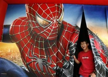 A man laughs as he comes out after watching Spiderman-3 promotional video in Hong Kong May 2, 2007. (REUTERS)