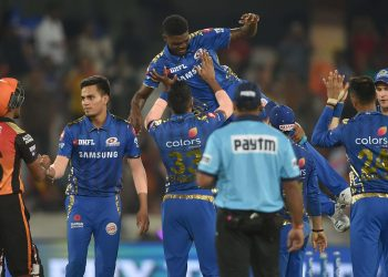 Mumbai Indians players celebrate their victory over Sunrisers Hyderabad by throwing Alzarri Joseph in the air after his six-wicket haul
