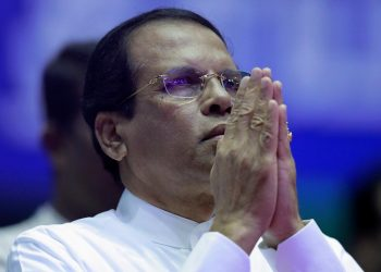 FILE PHOTO: Sri Lanka's President Maithripala Sirisena prays during a special party convention in Colombo, Sri Lanka December 4, 2018. REUTERS/Dinuka Liyanawatte