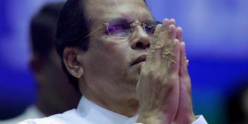 FILE PHOTO: Sri Lanka's President Maithripala Sirisena prays during a special party convention in Colombo, Sri Lanka December 4, 2018. REUTERS/Dinuka Liyanawatte