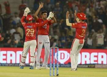 R Ashwin (C) celebrates with teammates after dismissing an opposition batsman, Tuesday