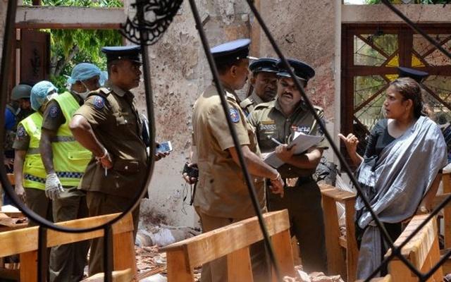 Crime scene officials inspect the site of a bomb blast inside a church in Negombo, Sri Lanka April 21, 2019. (REUTERS/Stringer)