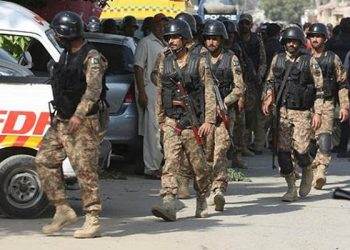 Unidentified gunmen donning uniforms of paramilitary soldiers Thursday massacred 14 passengers after forcing them to disembark from buses on a highway in the restive Balochistan province.