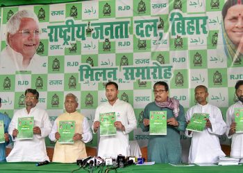 Patna: Rashtriya Janata Dal (RJD) leader Tejashwi Yadav, party spokesperson Manoj Jha and state President Ramchandra Purbey release RJD's election manifesto for the forthcoming Lok Sabha polls, at a press conference, in Patna, Monday, April 8, 2019. (PTI Photo)