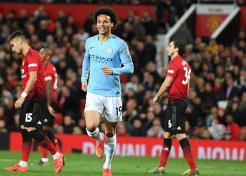 Leroy Sane (in blue) celebrates after scoring Manchester City's second goal against Manchester United, Wednesday