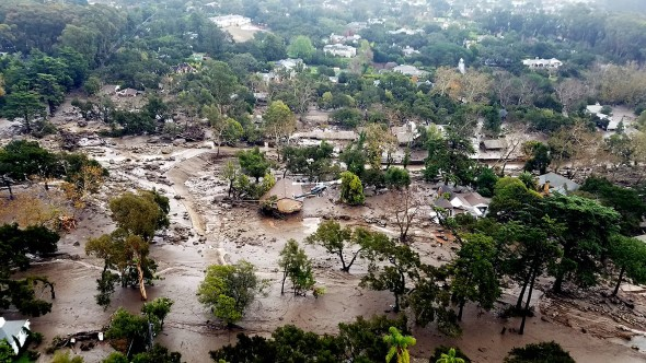This Jan. 10, 2018, file aerial photo provided by the Santa Barbara County Fire Department shows mudflow and damage to homes in Montecito, California. (Matt Udkow/Santa Barbara County Fire Department via AP)
