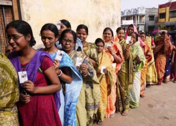 Voters queue up at a polling station in West Bengal