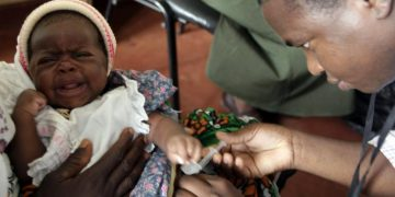 A child is given an injection as part of a malaria vaccine trial at a clinic in the Kenya coastal town of Kilifi, November 23, 2010. More than 90 percent of the world's malaria deaths occur in sub-Saharan Africa. JOSEPH OKANGA/REUTERS