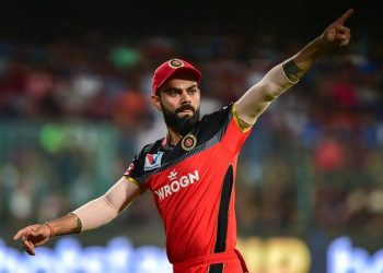 Bengaluru: RCB Skipper Virat Kohli gestures at his team members during the Indian Premier League 2019 (IPL T20) cricket match between Royal Challengers Bangalore (RCB) and Mumbai Indians (MI), at Chinnaswamy Stadium in Bengaluru, Thursday, March 28, 2019. (PTI Photo/Shailendra Bhojak) (PTI3_28_2019_000166B)