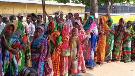 Women voters await their turn under sun at a booth in Purushottampur in Ganjam district, Thursday op photo