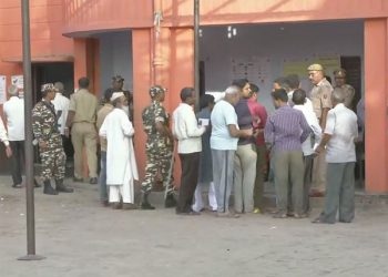 Polling in the presence of large number of security personnel in a booth in the Asansol Lok Sabha constituency