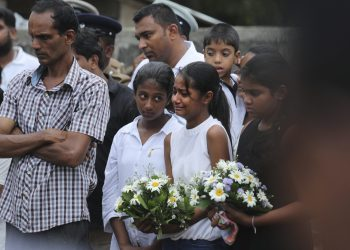 Negombo: Friends of Dhami Brandy, 13, who was killed during Easter Sunday's bomb blast at St. Sebastian Church, cries during funeral service in Negombo, Sri Lanka Thursday, April 25, 2019. The U.S. Embassy in Sri Lanka warned Thursday that places of worship could be targeted for militant attacks over the coming weekend, as police searched for more suspects in the Islamic State-claimed Easter suicide bombings that killed over 350 people. AP/PTI(AP4_25_2019_000164B)