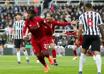 Divock Origi celebrates after scoring the match-winner for Liverpool against Newcastle United, Saturday