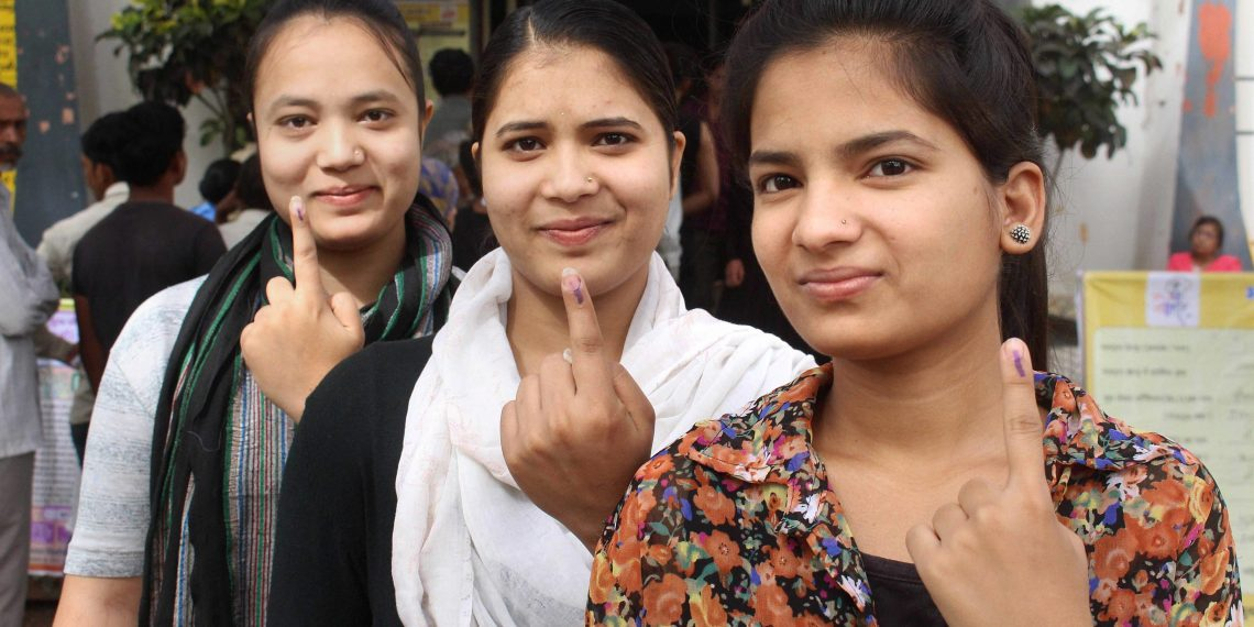 First time voters in Bhopal show their inked fingers after casting their votes, Sunday
