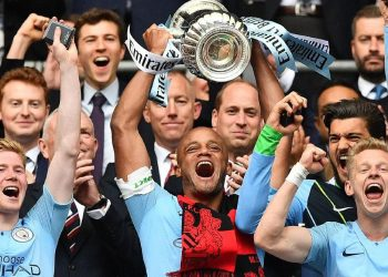 Manchester City players celebrate with the FA Cup after their win Saturday