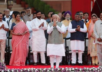 India's Prime Minister Narendra Modi gestures towards supporters after his oath during a swearing-in ceremony at the presidential palace in New Delhi, India May 30, 2019. REUTERS/Adnan Abidi