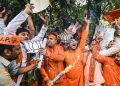 BJP workers celebrate their party's landslide win at the office of the saffron party in New Delhi