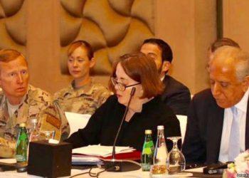 U.S. special envoy Zalmay Khalilzad (right) attends peace talks in Doha March 12.