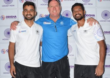 Coach of the Indian hockey team Graham Reid poses with skipper Manpreet Singh and vice-captain Birendra Lakra (L)