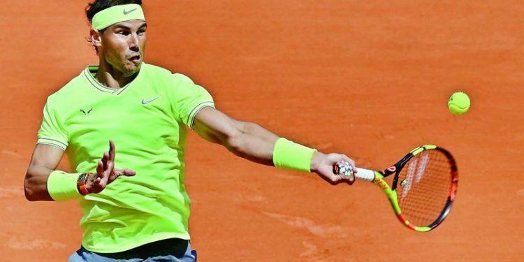 Rafael Nadal in action against Yannick Madenat the French Open, Wednesday