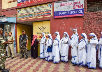 Nuns line up to cast their votes Sunday amid tight security at a polling booth in Kolkata