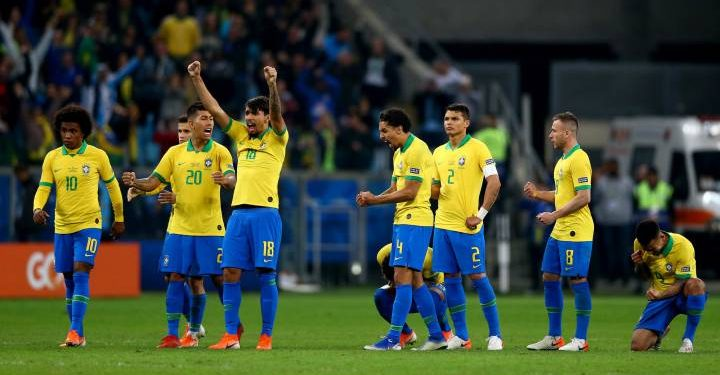 Brazilian players celebrate after winning the shootout against Paraguay