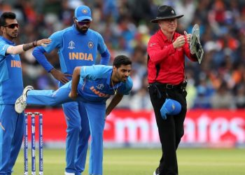 Bhuvneshwar Kumar stretches after suffering a hamstring niggle during the game against Pakistan