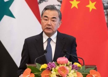 Chinese Foreign Minister Wang Yi speaks to journalists after a meeting with Syrian regime Foreign Minister Walid Muallem at Diaoyutai state guesthouse in Beijing on June 18, 2019. (AFP Photo)