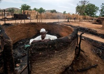 A man inside his burnt house in central Darfur. (Image: Reuters)