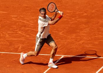 Roger Federer plays a backhand during his match at Roland Garros