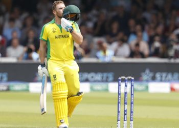 Aaron Finch kisses his helmet after reaching the three-figure mark against England, Tuesday