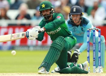 Mohammad Hafeez sweeps during his knock against Pakistan, Monday