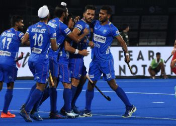 Indian players congratulate Harmanpreet Singh (2nd right) after he scored against Japan, Friday