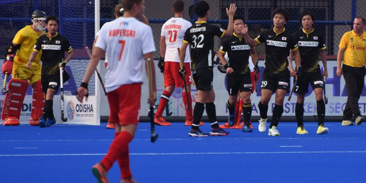 Japanese players celebrate after scoring a goal against South Africa, Wednesday
