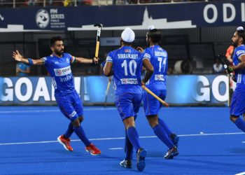 Skipper Manpreet Singh (L) celebrates with teammates after scoring against Poland at the Kalinga Stadium, Friday