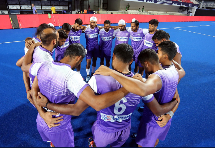 Players of the Indian men's hockey team go into a huddle during their training session, Wednesday