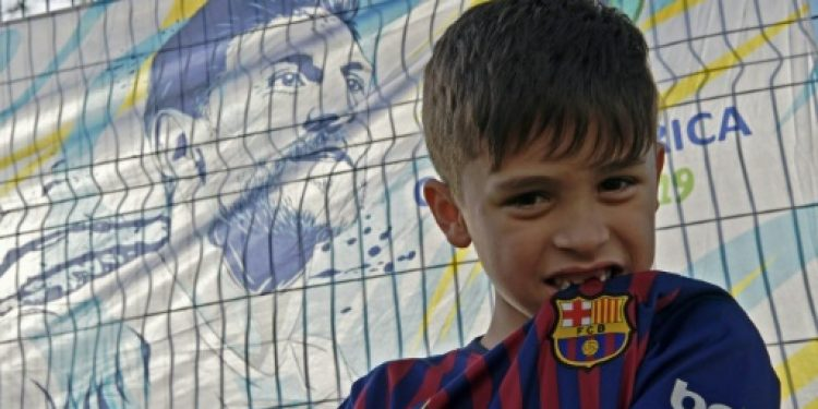 he six-year-old from Alvorada, a suburb of Porto Alegre, is waiting at the gates of the Beira Rio stadium alongside his mother Lisiana Maier, hoping to speak to Barcelona and Argentina superstar Messi.