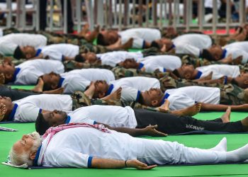 Prime Minister Narendra Modi performs yoga at a function in Ranchi to mark International Yoga Day